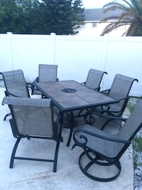 Rectangular black metal framed tile top patio table set Sarasota, 34231
