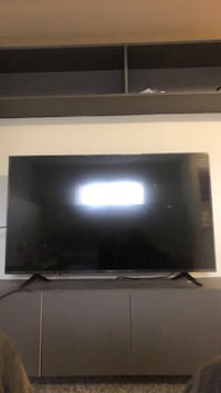 black flat screen TV with remote Calgary, T3J 2A6