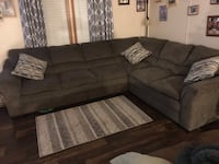brown fabric sectional sofa with throw pillows 1176 mi