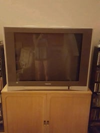 gray CRT TV with brown wooden TV hutch West Valley City, 84120