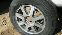 4 tires with rims 3 center caps 245/65/R17 Cabot
