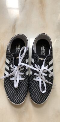 Pair of black-and-white adidas. Size 7 womens. Never worn Richmond Hill, L4C 5R5