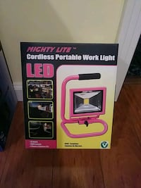 pink Mighty Lite cordless portable work light box