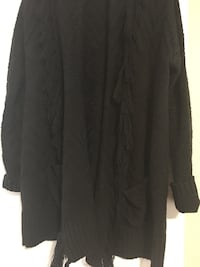 Black sweater with frills. Size large  Welland, L3C 5N7