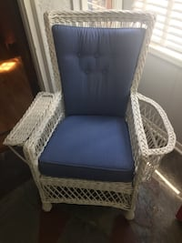 Nice wicker chair with newer cushions. It has a nice holder for magazines, books , etc., on one side   Des Moines, 50316