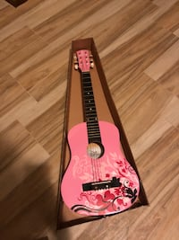 Pink and white acoustic guitar Oklahoma City, 73132