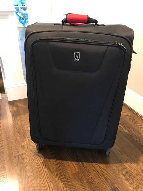 "Two large 29"" Travelpro suitcases used ONCE d28566f5-d636-4219-9f5d-432f68529076"