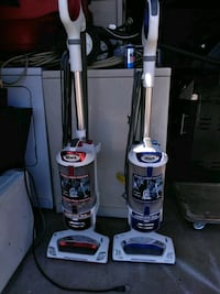 two white and purple Shark upright vacuum cleaners Phoenix, 85037