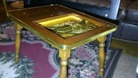 End tables with black woods relief carvings
