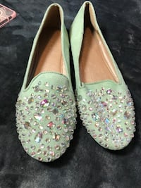 pair of teal leather flat shoes