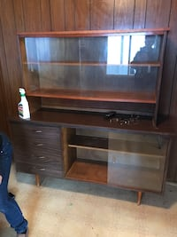 brown wooden TV hutch with flat screen television Calgary, T2A
