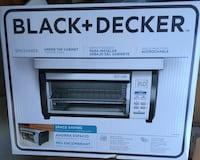 black and gray toaster oven brand new in the box. Glen Cove, 11542