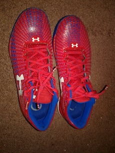 red and white Under Armour athletic shoes