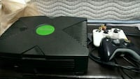 black Microsoft Xbox Original with two black and white controllers London, N6E 2B2