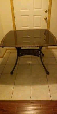 nice rattan table comes apart delivery