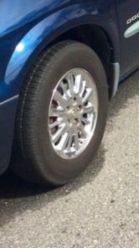 Town & Country rims, include 4 tires in very good condition $225. Casselberry, 32707