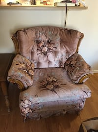 brown leather sofa chair with throw pillow