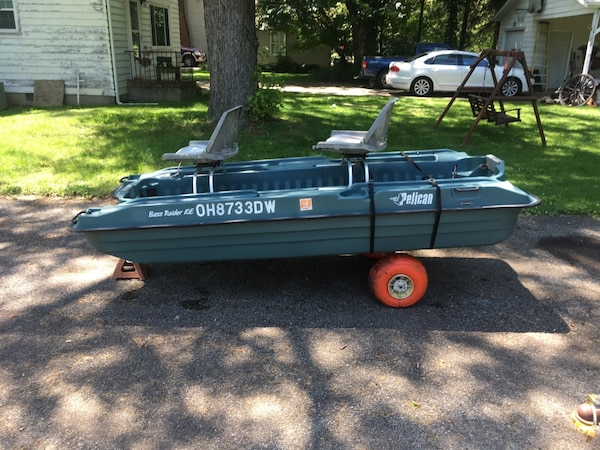 Pelican 10 ft bass raider boat with 2 seats and boateez carrier for hand  carting