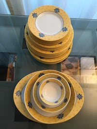 Yellow and white floral melamine dishes 39 pieces, in good condition.