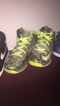 Pair of black-and-green nike basketball shoes Youngstown, 44515