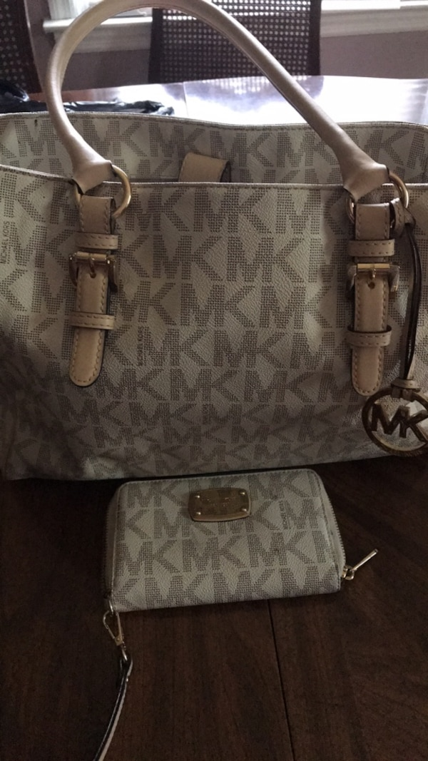 40e22de45f05 Used Michael Kors Purse with matching. wallet for sale in Griffin - letgo