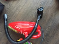 red and black canister vacuum cleaner Vancouver, V6B