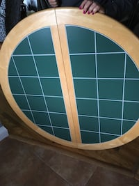 round beige and green table