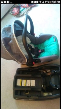 baby's black and gray car seat carrier with base screenshot