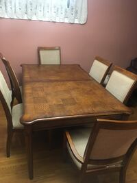 Real wood extendable table with chairs. Great condition.
