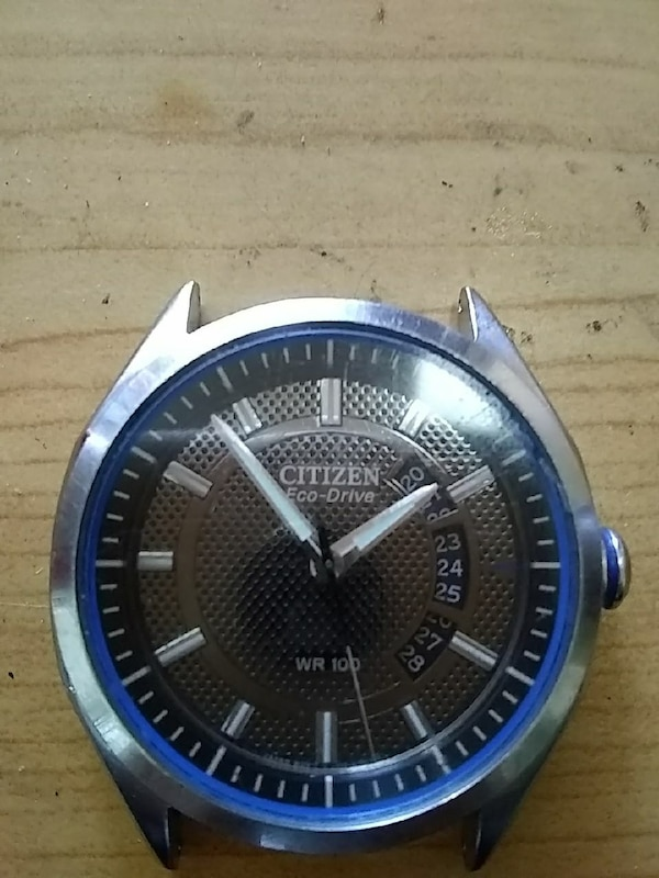 round silver and blue analog watch with black leather strap