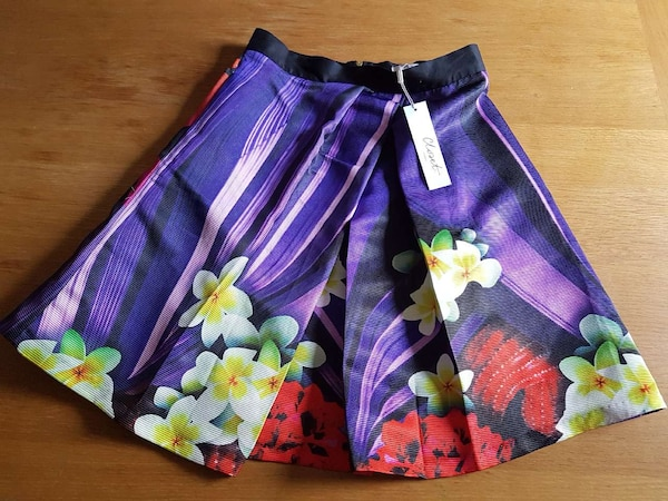 d51e264209 Used purple, white, yellow, red, and black floral satin skirt for sale in  London - letgo
