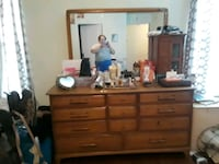 Antique pecan wood triple dresser with mirror