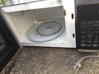 White and black microwave oven 43 km