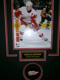 Nicklas Lidstrom famed Picture and Puck  London, N6C 1P7