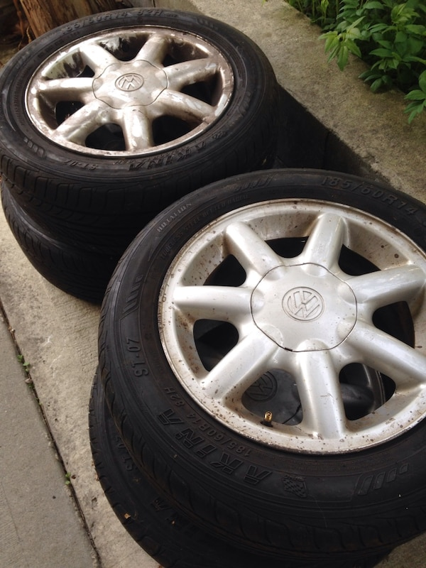 Two gray volkswagen multi-spoke wheel with tires