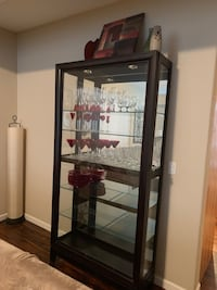 Dania Tall display cabinet with lights and sliding door