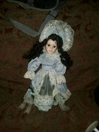 porcelain doll in white dress Magee, 39111