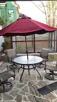Round brown metal table with four swivel chairs patio set Arlington, 22207