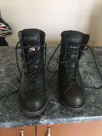 Pair of black leather work boots 731 km
