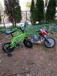 toddler's green and black bicycle with training wheels North Vancouver, V7M
