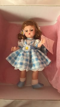 Porcelain doll in blue and white dress 24 km