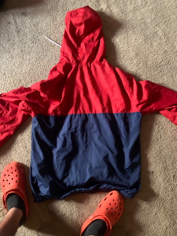 Red and blue windbreaker  87924058-3208-48e5-86d2-86041a87627a