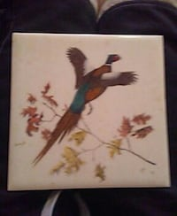 frameless painting of bird and flowers 131 mi