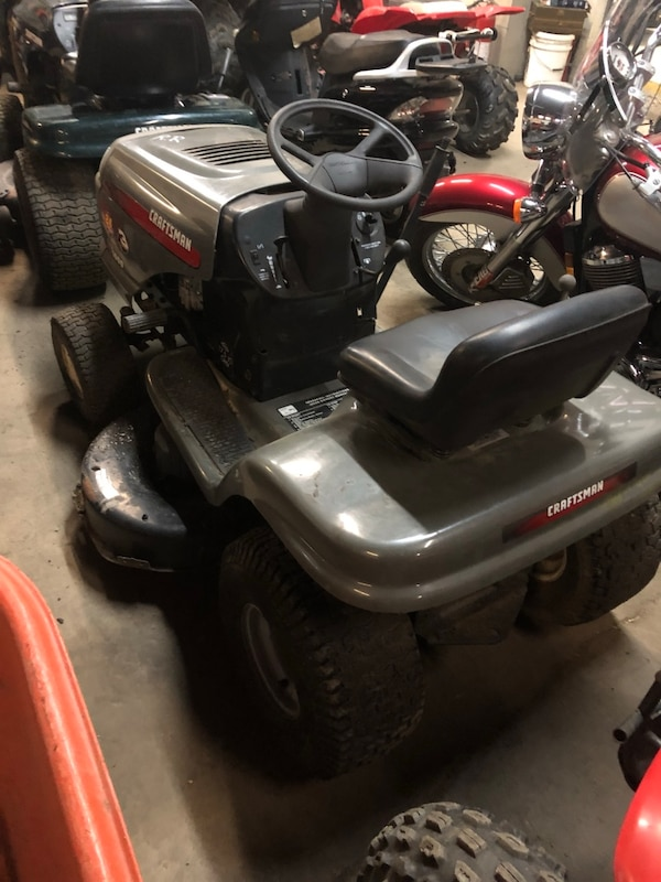 Black and gray craftsman ride on lawn mower 68faea6a-d02a-4df4-83cf-20daed7e367b