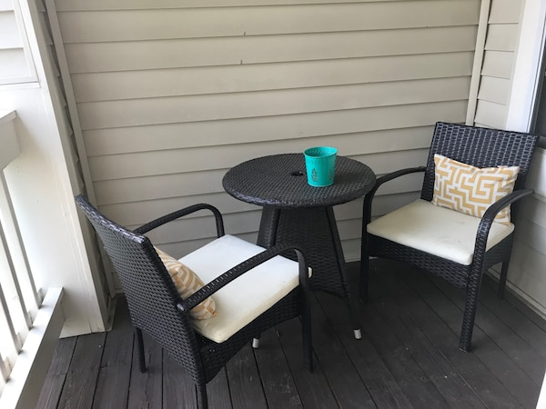 Black wooden framed glass top table with chairs