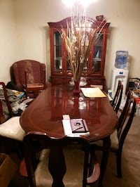 brown wooden dining table set along with the curio Columbia, 29210