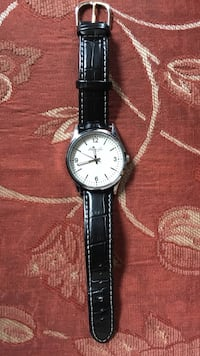 round silver analog watch with black leather strap Austin, 78726