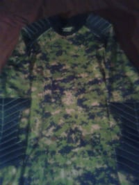 green and black camouflage jacket Colorado Springs, 80917