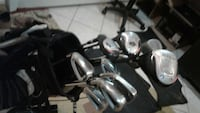 Left hand golf clubs and ping bag
