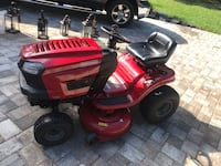red and black ride on mower Odessa, 33556